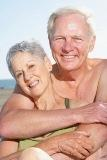 Couple posing together at beach, California